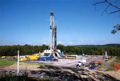 A fracking rig and operation stands among forests and fields in Bradford County, Pa.