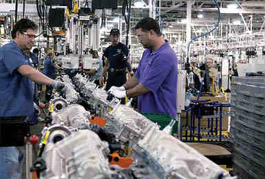 Workers at Ford Cleveland Engine Plant #1 assemble Duratec V-6s.